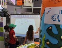 Kids Interacting with their books made with Q-Tales